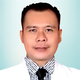 drg. Muharlin merupakan dokter gigi di RS Dr. A.K Gani Palembang di Palembang